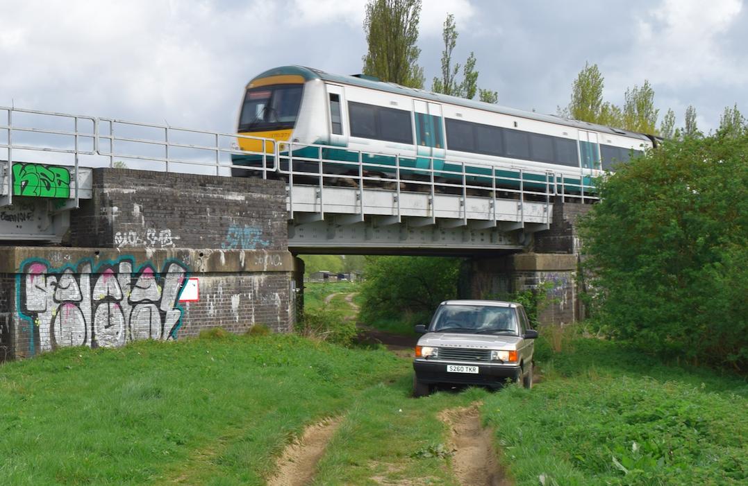 Off the Rails: Range Rover vs train